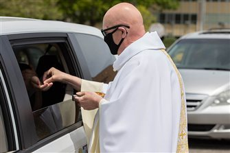 Faithful, priests celebrate first-time gathering for in-car Masses