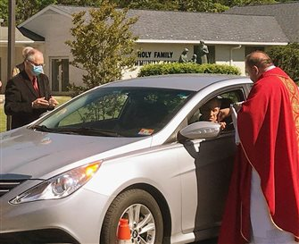 Parishes mark Pentecost with in-car Masses